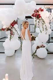 wedding arch balloons picture of a wedding arch of oversized white balloons foliage and