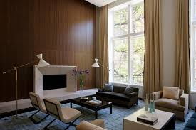 living room contemporary with wood panel walls next to wood