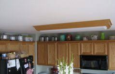 Lights Above Kitchen Cabinets Decorate Above Kitchen Cabinets Brown Wood Cupboard Undermount