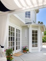 photos hgtv cape cod style house with patio pergola curtains