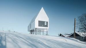 Winter House Delordinaire Raises High House Above Snowy Quebec Countryside To