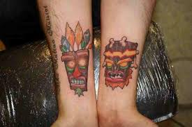 aku aku and uka uka tattoos on forearm