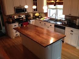 recycled countertops white kitchen island with butcher block top