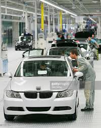 bmw factory tour bmw inaugurates new production line in leipzig photos and images