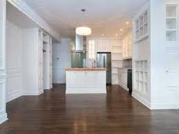 weekend open house tour under 700 000 in east boston 65 the pitch the first floor unit includes hardwood floors shaker style custom kitchen with a butcher block top island spacious deck and a red brick