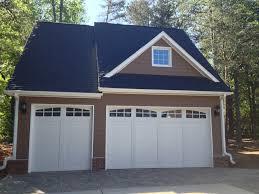 white carriage house style garage doors detached door car detached garage cornelius henderson building group