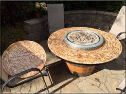wine barrel fire table turn a wine barrel into a fire pit table diy projects for everyone