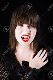 teen vampire with sharp nails and formidable fangs stock
