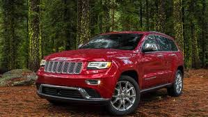 jeep red 2014 jeep grand cherokee red driving in line