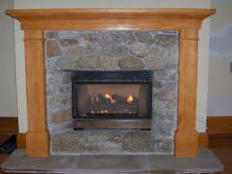 simply fireplace design with wooden fireplace mantel kits surrounded with stone for home decoration ideas