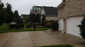 there is a pro dunk silver basketball system on the side of his