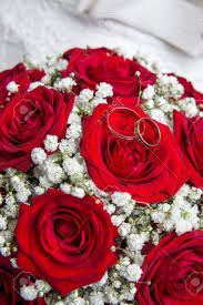 red rose rings images Two beautiful engagement rings and bridal bouquet of red roses jpg