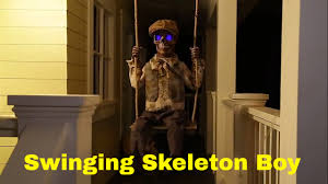 skelly bones spirit halloween swinging skeleton boy animated halloween prop youtube