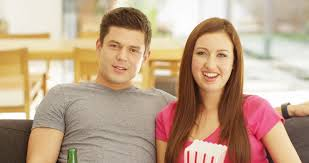 comedy film video clip 4k cheerful young couple watching a comedy movie at home stock