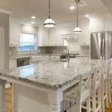 White Kitchen Dark Wood Floors Marble Backsplash Colonial White - Granite on white kitchen cabinets
