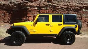 yellow jeep wrangler unlimited 2015 jeep wrangler unlimited sport tate u0027s trucks center