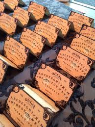 halloween wedding place cards designed like ouija boards to