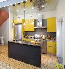 Mini Pendant Lighting For Kitchen Island by Mini Pendant Lamps Above Small Black Kitchen Island With Yellow