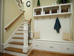 beside stairs mudroom bench with coat hook and triple drawer for