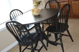 black round pedestal table black round dining table and chairs