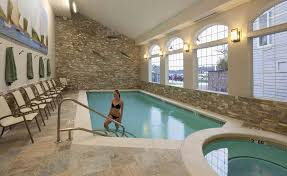 Interior Swimming Pool Houses Striking Indoor Swimming Pool Design Beige Textured Stone Wall