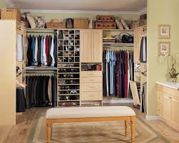 closet design layout with wooden varnishing frames and hanging