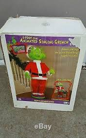 grinch christmas decoration 5 foot grinch singing animated christmas decoration size gemmy