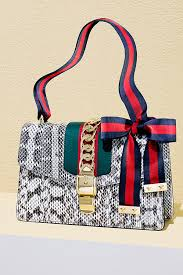 bags of bows classic gucci remixed with an oversize bow and bold gold details