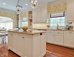 brown granite countertops with white cabinets white kitchen cabinets with granite countertops transitional