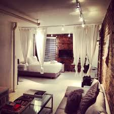 Bedroom Curtain Design And Exposed by Like The Curtains As A Partition And The Exposed Brick Dream