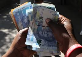 running out of us dollars zimbabwe says it will print its own
