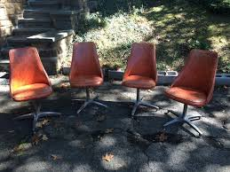 Kitchen Chairs On Wheels Swivel Set Of Four Orange Vinyl Swivel Chairs On Metal Bases Attainable