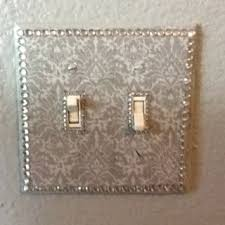 try decoupaging your light switch covers for a hollywood glam