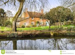 cottage next to water stock photo image 49491111