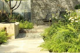 Small Townhouse Backyard Ideas Backyard Landscaping Ideas Dense Greenery Complemented By A Rock