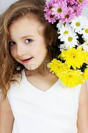 Cute little girl with flowers  Stock Photo  Colourbox