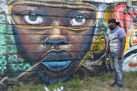 margaretta s jua kali diary graffiti art at dust depo and kenya below is bankslave with his blue lips chela chelagat with her african king eljay mutua with his africa rising mural and members of the bomb squad at work