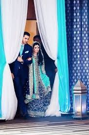engagement lengha blue lengha and matching tie for groom at engagement party