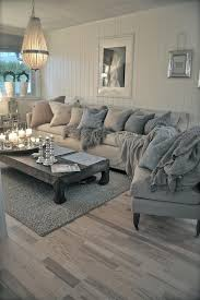coffee table grey living room room with white panelled walls and grey coffee table