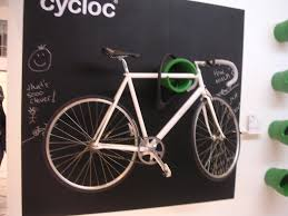bike storage for small apartments simple wall mount bike racks placed under small wooden shelf on