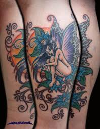butterfly fairy with flowers tattoo by muddygreen on deviantart