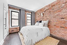 flexible pad with plenty of exposed brick and a terrace asks 985k