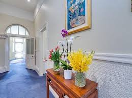 hallway decorating ideas for modern housing designoursign cool wainscoting and framed painting feat best indoor flowers hallway decorating idea plus wooden console table