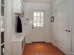 traditional mud room with built in bookshelf u0026 terracotta tile