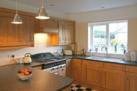 u shaped kitchenns layout picture with seating island photo