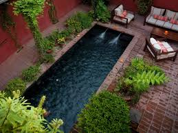 some helpful small garden ideas for the diy project for making the long pool completed small garden ideas with brick flooring and wooden outdoor table and sofas