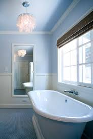 contemporary bathroom with blue penny tile floor and soaking tub
