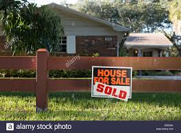 ranch style house with for sale and sold sign on front decorative