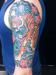 tiger half sleeve complete traditional japanese tattooing by
