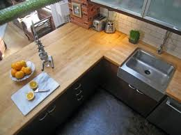 seattle loft condo kitchen with heated stained concrete floor if there is money left maybe consider redoing the countertops butcher block counters